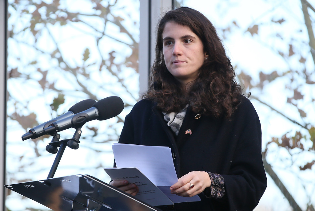 Description of . Tatiana Schlossberg granddaughter of President J.F. Kennedy makes a short speech during a ceremony at the JFK memorial at Runnymede, England, Friday, Nov. 22, 2013. A short ceremony took place at the JFK memorial which overlooks the site of the signing go the Magna Carta in 1215. Friday is the 50th anniversary of the assassination of President John F. Kennedy in Dallas. (AP Photo/Alastair Grant)