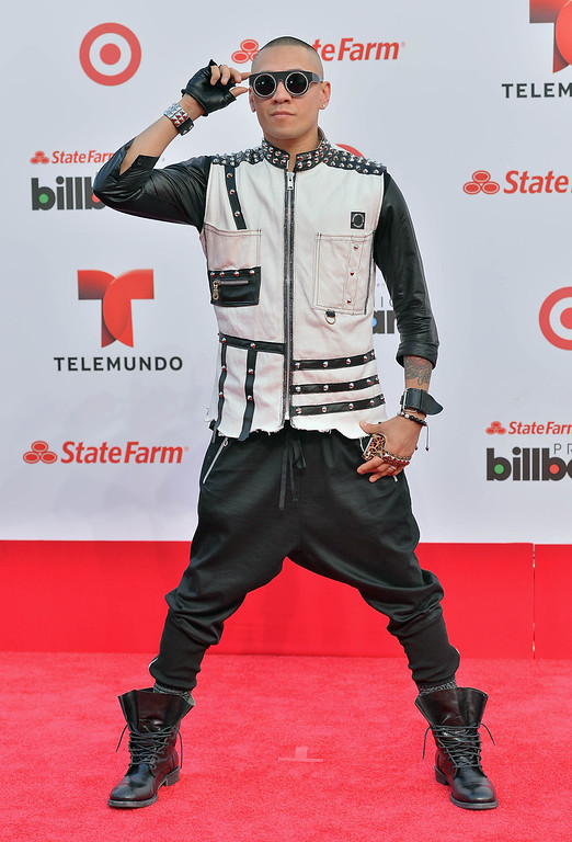 Description of . MIAMI, FL - APRIL 25:  Taboo of The Black Eyed Peas arrives at Billboard Latin Music Awards 2013 at Bank United Center on April 25, 2013 in Miami, Florida.  (Photo by Gustavo Caballero/Getty Images)