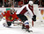 Colorado Avalanche center John Mitchell (7) scores on Chicago Blackhawks goalie Ray Emery during the first period of an NHL hockey game, Wednesday, March 6, 2013, in Chicago. (AP Photo/Charles Rex Arbogast)