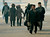 North Koreans walk in Pyongyang, in this photo taken by Kyodo December 12, 2012. Isolated and impoverished North Korea launched its second long- range rocket of 2012 on Wednesday and may have finally succeeded in putting a satellite into space, the stated aim of what critics say is a disguised ballistic missile test.   REUTERS/Kyodo