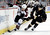 Anaheim Ducks right wing Kyle Palmieri, right, battles Colorado Avalanche right wing P.A. Parenteau for the puck during the first period of an NHL hockey game in Anaheim, Calif., Sunday, Feb. 24, 2013. (AP Photo/Chris Carlson)