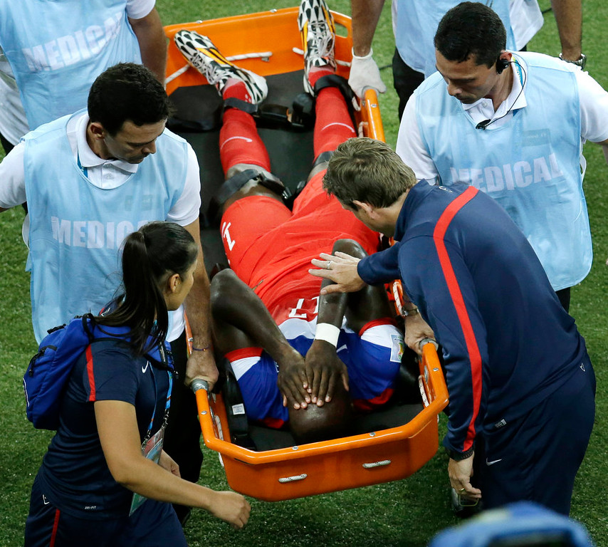 Description of . United States' Jozy Altidore is carried off the field during the group G World Cup soccer match between Ghana and the United States at the Arena das Dunas in Natal, Brazil, Monday, June 16, 2014. (AP Photo/Hassan Ammar)