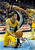Denver forward Danilo Gallinari (8) went to the floor to control a rebound in front of Spurs forward Tim Duncan (21) in the first half. The Denver Nuggets defeated the San Antonio Spurs 112-106 at the Pepsi Center Tuesday night, December 18, 2012. Karl Gehring/The Denver Post