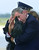 President Bush does his best to salute while holding his dog Barney as they get off of Air Force One at Andrews Air Force Base, Md., Monday, June 25, 2001. Bush spent the afternoon in Detroit for the annual U.S. Conference of Mayors where he called on the mayors support for more faith-based initiatives. (AP Photo/Susan Walsh)