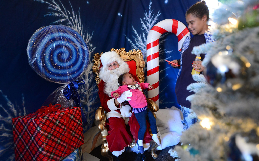 Description of . Omiah Panton, 18 months, cries for her mommy who placed her on Santa's lap inside a Winter Wonderland tent at a Christmas Eve meal hosted by the Los Angeles Mission on December 24, 2013 along Skid Row in downtown Los Angeles, California. The LA Mission was established in 1936 as a soup kitchen and Christian outreach to the homeless and today, with the help of many volunteers, a Christmas celebration was made possible for the impoverished and marginalized members of society.    FREDERIC J. BROWN/AFP/Getty Images
