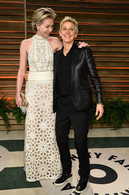 Description of . Actress Portia de Rossi (L) and TV personality Ellen DeGeneres attend the 2014 Vanity Fair Oscar Party hosted by Graydon Carter on March 2, 2014 in West Hollywood, California.  (Photo by Pascal Le Segretain/Getty Images)