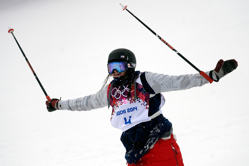 Description of . U.S.A. skier Devin Logan raises her poles and extends her arms after wrecking during the women\'s ski slopestyle final. Sochi 2014 Winter Olympics on Tuesday, February 11, 2014. (Photo by AAron Ontiveroz/The Denver Post)
