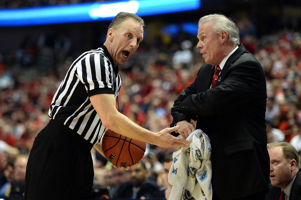 Description of . Head coach Bo Ryan of the Wisconsin Badgers argues a call with a referee in the first half while taking on the Arizona Wildcats during the West Regional Final of the 2014 NCAA Men's Basketball Tournament at the Honda Center on March 29, 2014 in Anaheim, California.  (Photo by Harry How/Getty Images)