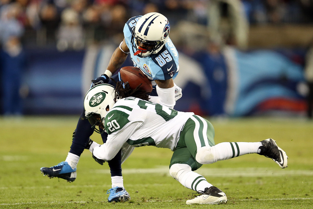Description of . NASHVILLE, TN - DECEMBER 17:  Wide receiver Nate Washington #85 of the Tennessee Titans gets tackled by cornerback Kyle Wilson #20 of the New York Jets at LP Field on December 17, 2012 in Nashville, Tennessee.  (Photo by Andy Lyons/Getty Images)