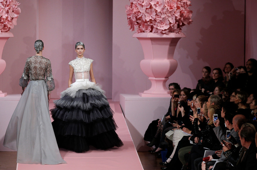 Description of . A model presents a creation by French fashion designer Alexis Mabille for his  Spring Summer 2013 Haute Couture fashion collection, presented in Paris, Monday, Jan. 21, 2013. (AP Photo/Christophe Ena)
