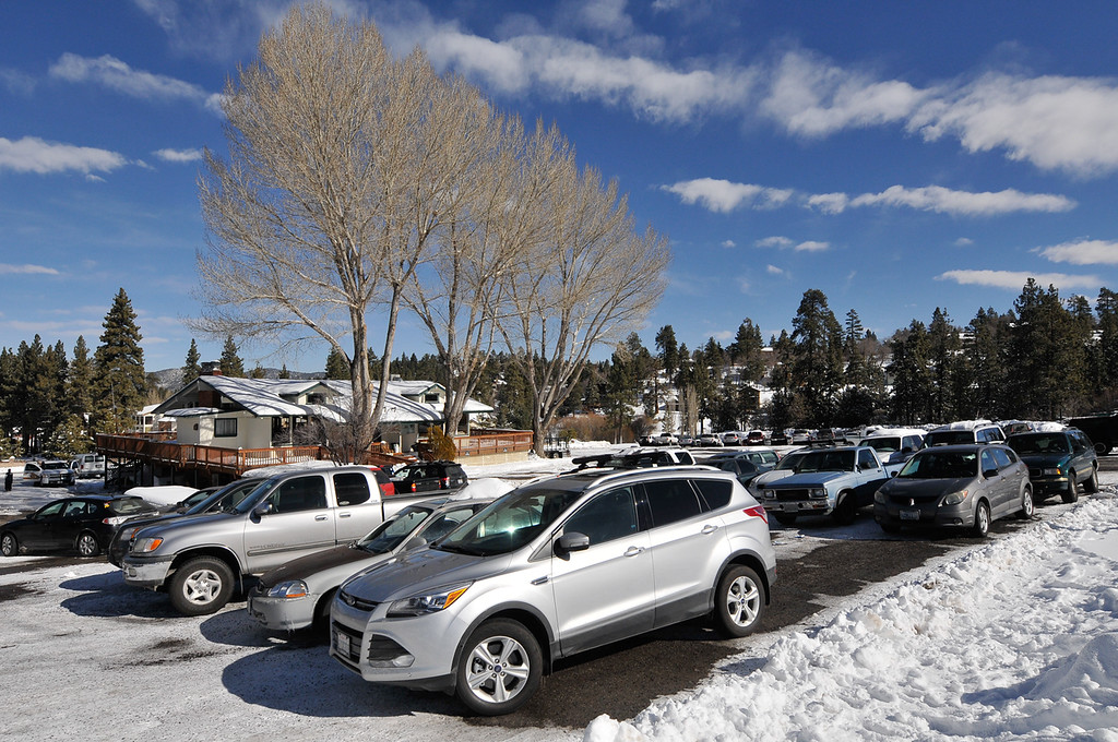 Description of . A parking lot that once housed the command post for the Christopher Dorner manhunt is reopened to skiers and snowboards in Big Bear on Sunday, Feb. 10, 2013. Search crews were reduced 25 personnel on Sunday from 50 the day before. (Rachel Luna / Staff Photographer)
