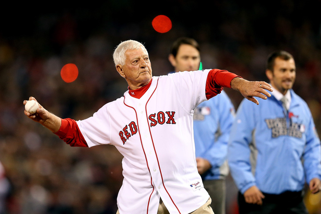 Description of . Former Red Sox great and Hall-of-Famer Carl Yastrzemski throws out the ceremonial first pitch before Game One of the 2013 World Series between the Boston Red Sox and the St. Louis Cardinals at Fenway Park on October 23, 2013 in Boston, Massachusetts.  (Photo by Rob Carr/Getty Images)
