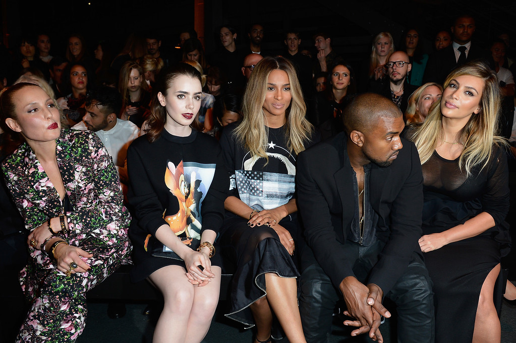 Description of . PARIS, FRANCE - SEPTEMBER 29:  Actresses Noomi Rapace, Lily Collins, singer Ciara, Kanye West and Kim Kardashian attend the Givenchy show as part of the Paris Fashion Week Womenswear  Spring/Summer 2014 on September 29, 2013 in Paris, France.  (Photo by Pascal Le Segretain/Getty Images)