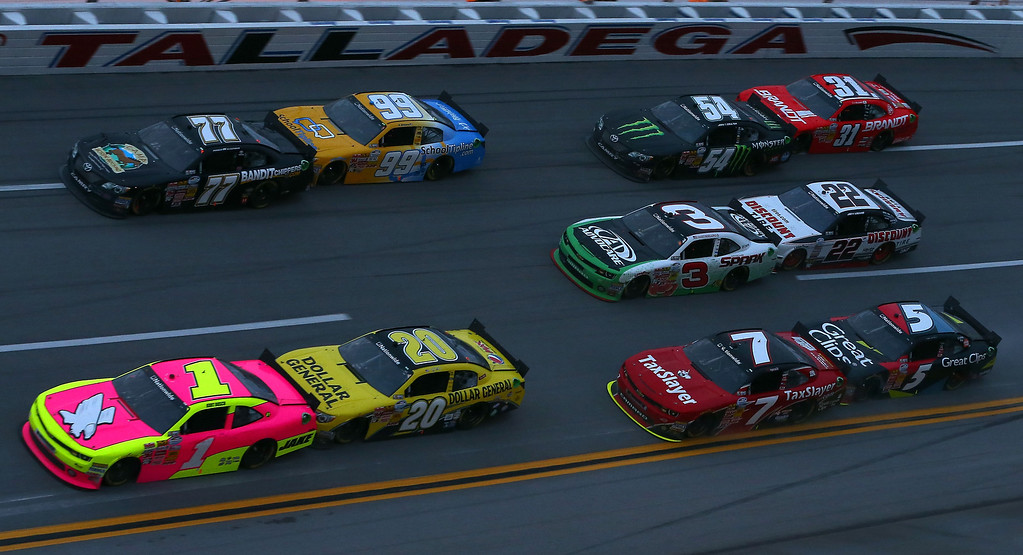 Description of . TALLADEGA, AL - MAY 04:  Kurt Busch, driver of the #1 Phoenix Construction Chevrolet, leads a pack of cars during the NASCAR Nationwide Series Aaron's 312 at Talladega Superspeedway on May 4, 2013 in Talladega, Alabama.  (Photo by Tom Pennington/Getty Images)