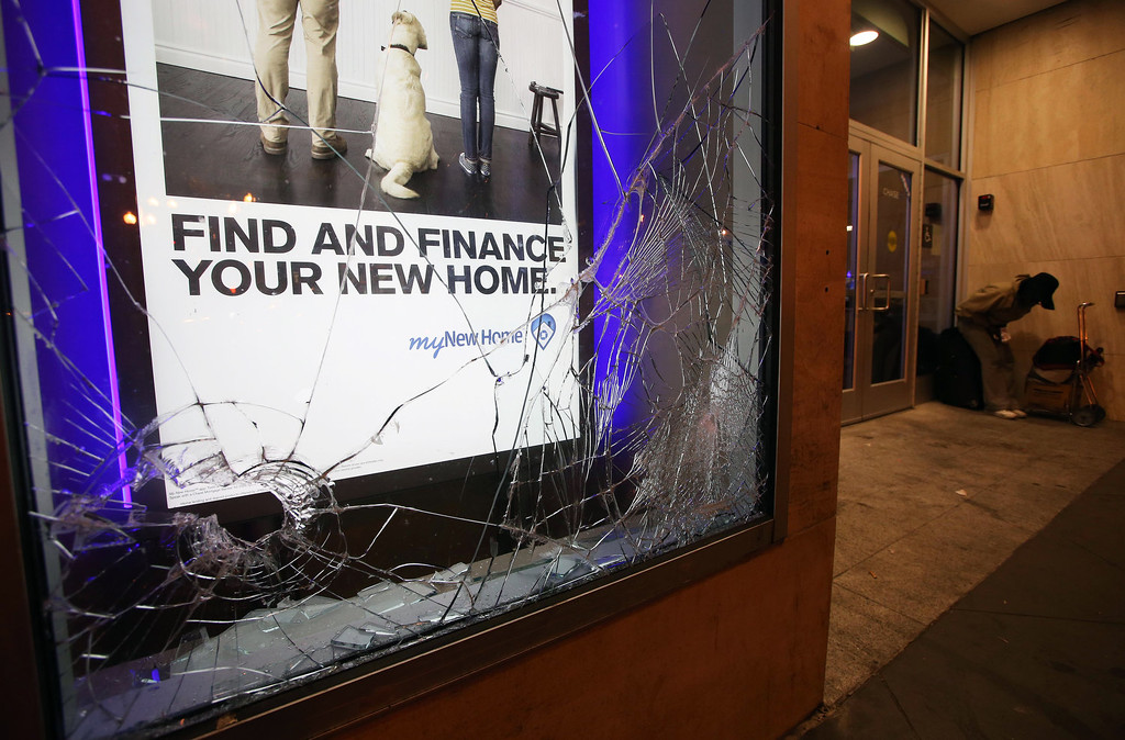 Description of . A window is smashed at a Chase Bank in Oakland, Calif., early Sunday, July 14, 2013, following protests after George Zimmerman was found not guilty in the 2012 shooting death of teenager Trayvon Martin. Protesters angered by the acquittal Zimmerman held largely peaceful demonstrations in three California cities, but broke windows and started small street fires in Oakland, police said. (AP Photo/Bay Area News Group, Jane Tyska)