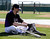 Colorado Rockies' Todd Helton puts on his batting glove before taking batting practice during a spring training baseball workout Sunday, Feb. 17, 2013, in Scottsdale, Ariz. (AP Photo/Darron Cummings)