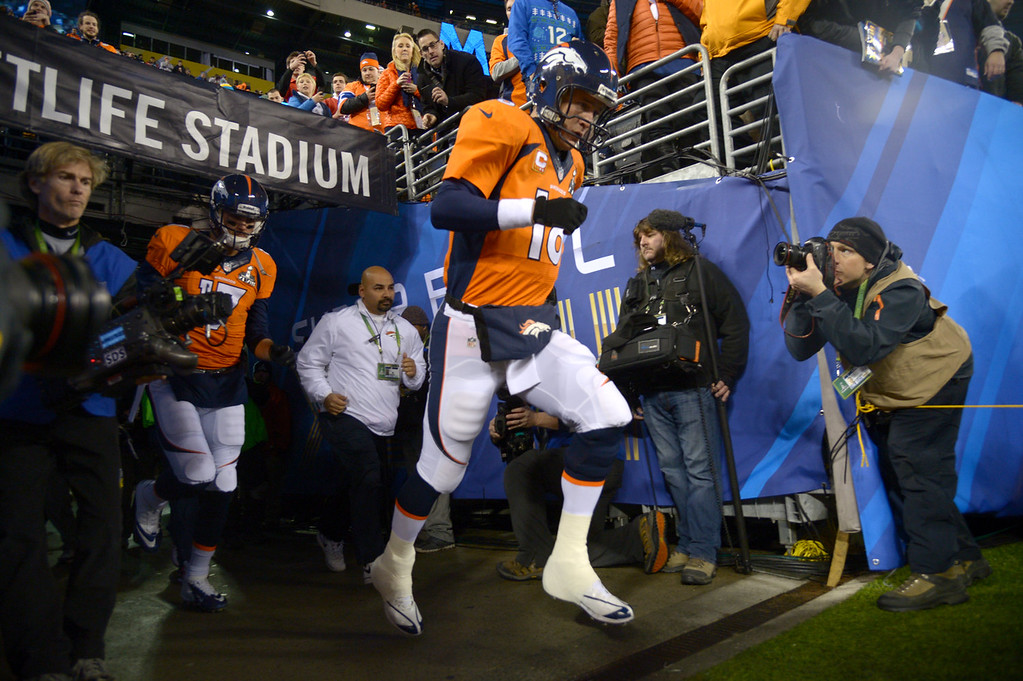 Description of . Denver Broncos quarterback Peyton Manning (18) runs on the field for warmups before the game. The Denver Broncos vs the Seattle Seahawks in Super Bowl XLVIII at MetLife Stadium in East Rutherford, New Jersey Sunday, February 2, 2014. (Photo by John Leyba/The Denver Post)