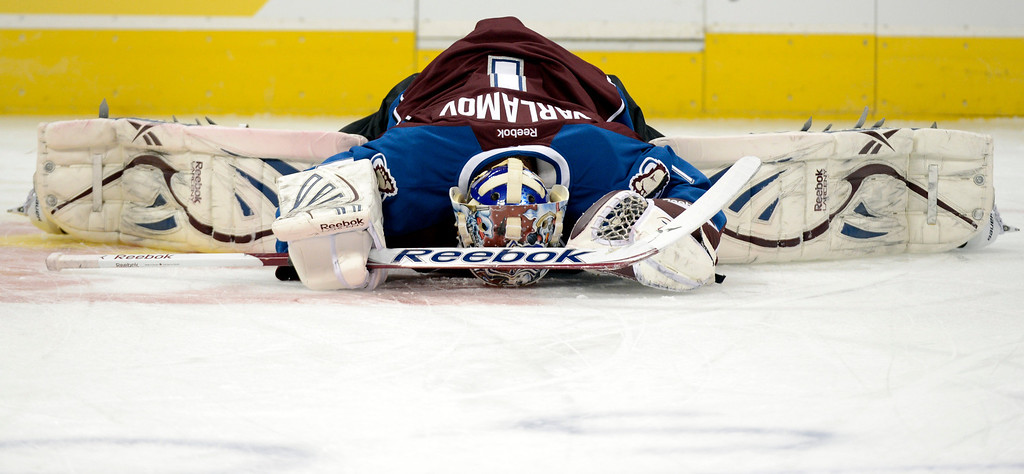 Description of . DENVER, CO. - JANUARY 22: Colorado Avalanche goalie Semyon Varlamov (1) stretches during the pre-skate of their first home game of the NHL season. The Colorado Avalanche hosted the Los Angeles Kings at the Pepsi Center on January, 22, 2013.    (Photo By John Leyba / The Denver Post)