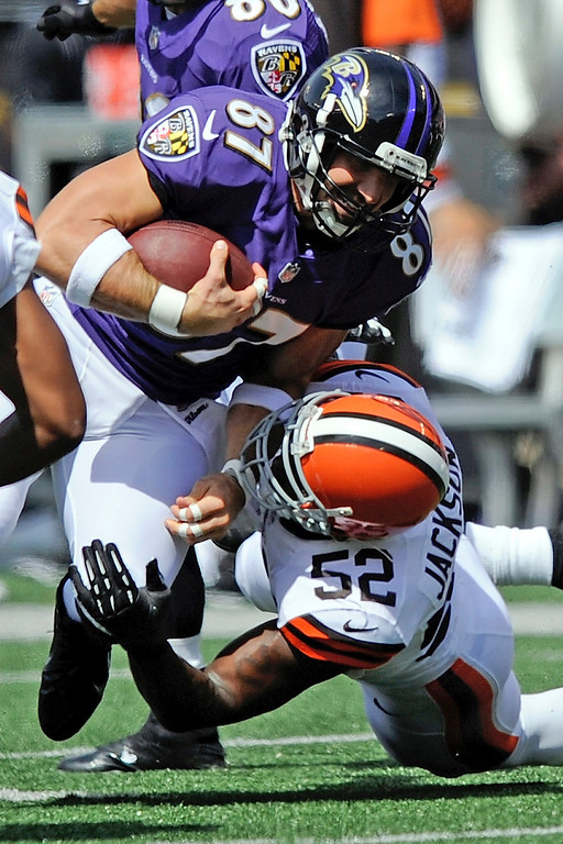 . Baltimore Ravens tight end Dallas Clark (87) is tackled by Cleveland Browns inside linebacker D\'Qwell Jackson (52) during the first half of a NFL football game in Baltimore, Md., Sunday, Sept. 15, 2013. (AP Photo/Nick Wass)