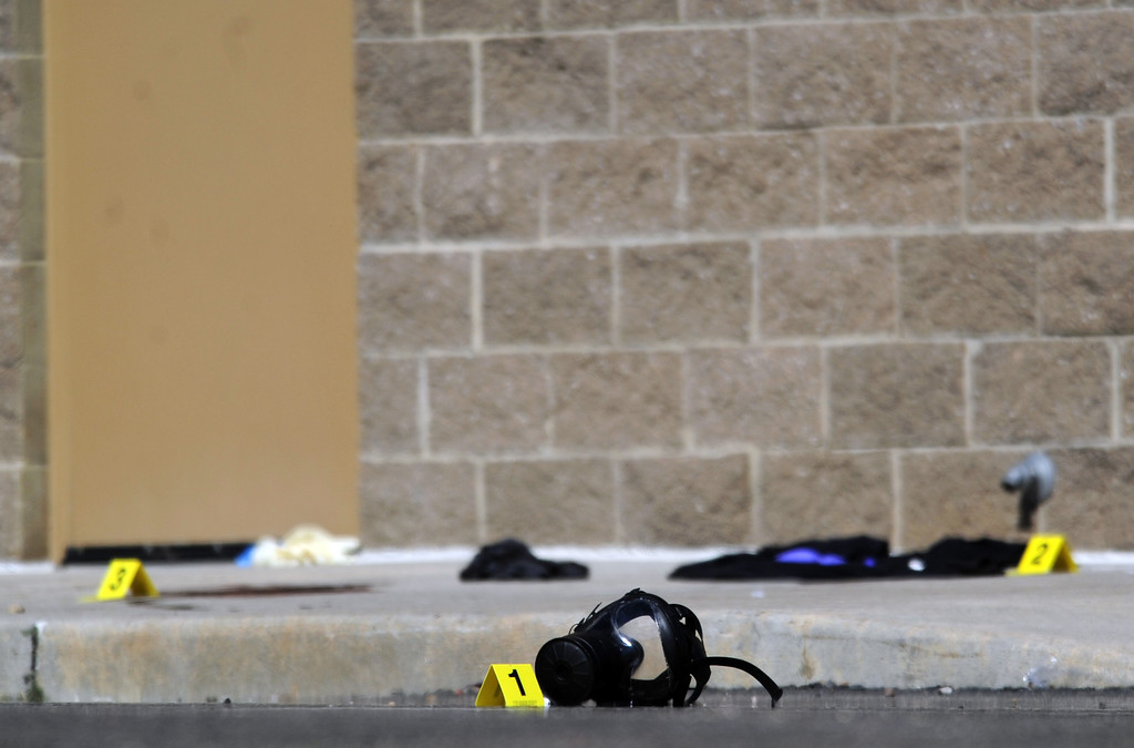 Description of . Agents from the FBI and ATF investigate the scene behind the Century 16 theater in Aurora where 12 people were killed and dozens of others were injured during a premiere of The Dark Knight Rises on Friday, July 20, 2012 in Aurora. AAron Ontiveroz, The Denver Post