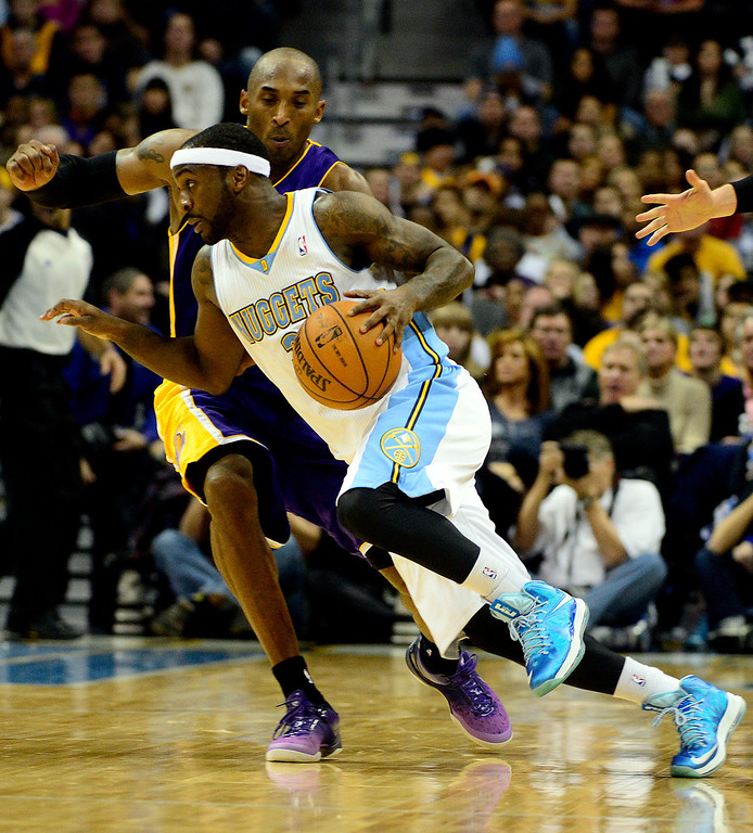 Description of . Denver Nuggets point guard Ty Lawson (3) drives on Los Angeles Lakers shooting guard Kobe Bryant (24) during the second half of the Nuggets' 126-114 win at the Pepsi Center on Wednesday, December 26, 2012. AAron Ontiveroz, The Denver Post