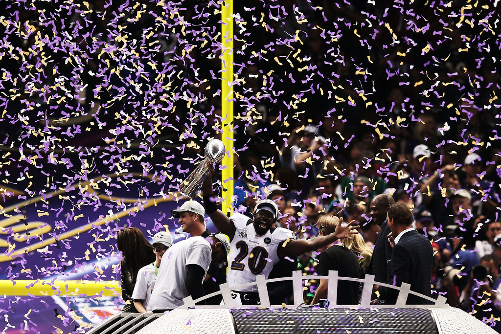 Description of . Ed Reed #20 of the Baltimore Ravens celebrates with the Vince Lombardi trophy after the Ravens won 34-31 against the San Francisco 49ers during Super Bowl XLVII at the Mercedes-Benz Superdome on February 3, 2013 in New Orleans, Louisiana.  (Photo by Win McNamee/Getty Images)