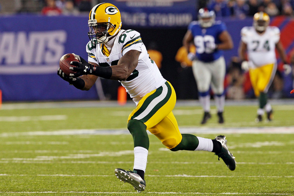 Description of . Green Bay Packers wide receiver James Jones catches a pass during the first half of an NFL football game against the New York Giants, Sunday, Nov. 17, 2013, in East Rutherford, N.J.  (AP Photo/Peter Morgan)
