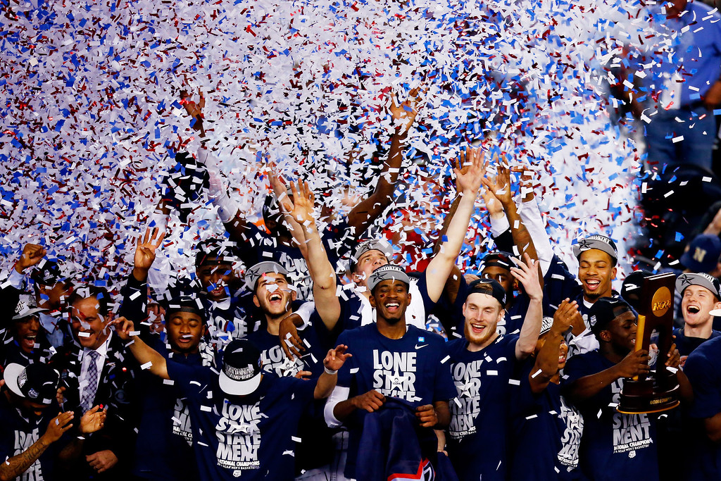 Description of . ARLINGTON, TX - APRIL 07:  The Connecticut Huskies celebrate after defeating the Kentucky Wildcats 60-54 in the NCAA Men\'s Final Four Championship at AT&T Stadium on April 7, 2014 in Arlington, Texas.  (Photo by Tom Pennington/Getty Images)