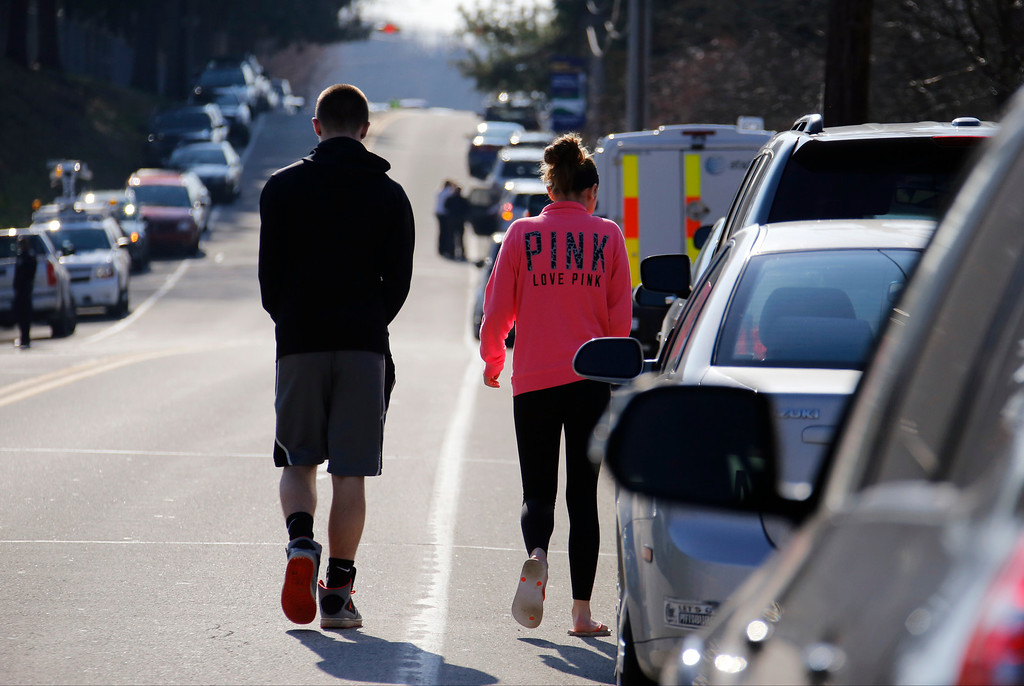 Description of . Studentswalk down the street away from the campus of the Franklin Regional School District, where several people were stabbed at Franklin Regional High School, on Wednesday, April 9, 2014, in Murrysville, Pa., near Pittsburgh. The suspect, a male student, was taken into custody and being questioned. (AP Photo/Gene Puskar)