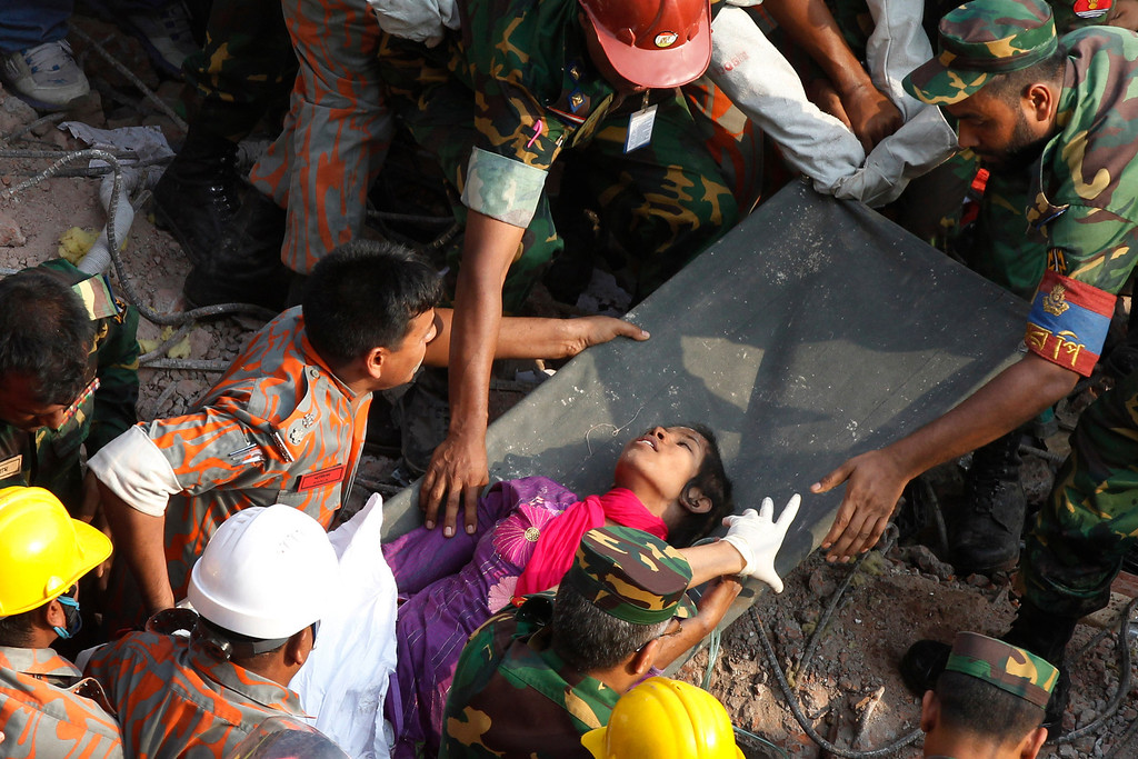 Description of . Survivor Reshma Begum lies on a stretcher after being pulled out from the rubble of a building that collapsed in Savar, near Dhaka, Bangladesh, Friday, May 10, 2013. Begum was working in a factory on the second floor of Rana Plaza when the building began collapsing around her April 24. She raced down a stairwell into the basement, where she became trapped near a Muslim prayer room in a wide pocket that allowed her to survive, she told the private Somoy TV. (AP Photo)
