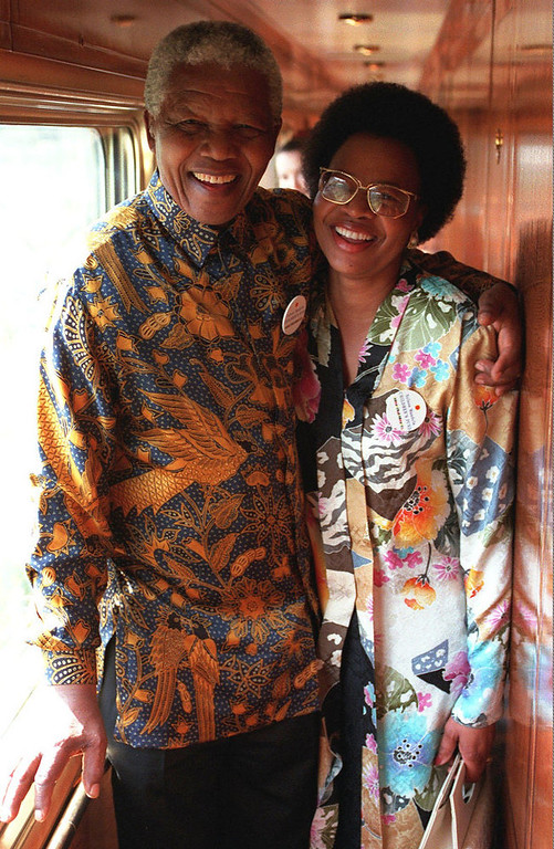 Description of . South African President Nelson Mandela stands with Graca Machel, wife of the late former President of Mozambique Samora Machel, in this undated photo. According to South African news reports Thursday, July 16, 1998,  the couple are expected to marry on Saturday July 18, 1998, his 80th birthday, at a private ceremony at his home in Johannesburg. (AP Photo/Benny Gool)