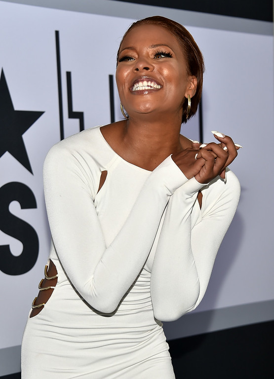 Description of . Actress Eva Marcille poses in the Winners Room during the BET AWARDS '14 at Nokia Theatre L.A. LIVE on June 29, 2014 in Los Angeles, California.  (Photo by Alberto E. Rodriguez/Getty Images for BET)