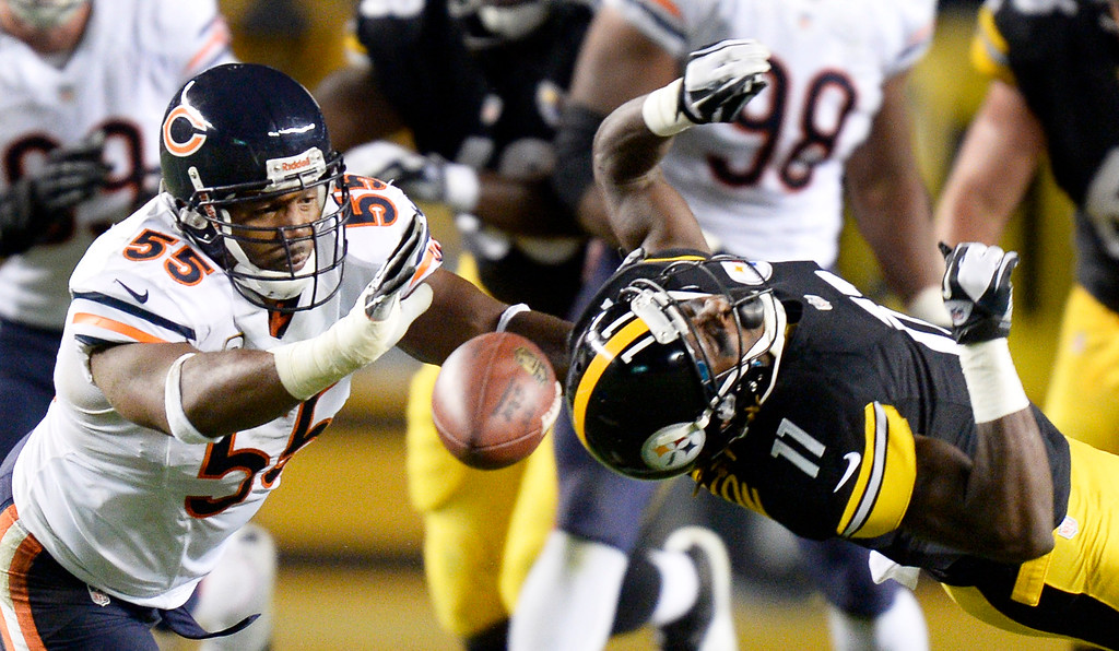 Description of . Pittsburgh Steelers wide receiver Markus Wheaton (11) can't catch a pass in front of Chicago Bears outside linebacker Lance Briggs (55) in the second quarter of an NFL football game on Sunday, Sept. 22, 2013, in Pittsburgh. (AP Photo/Don Wright)