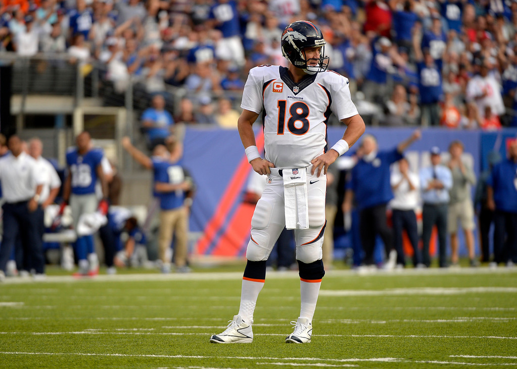Description of . Quarterback Peyton Manning (18) of the Denver Broncos looks to the Denver bench in disbelief after running back Montee Ball (28) of the Denver Broncos fumbled at the 3 yard line agains the New York Giants September 15, 2013 MetLife Stadium. (Photo by John Leyba/The Denver Post)