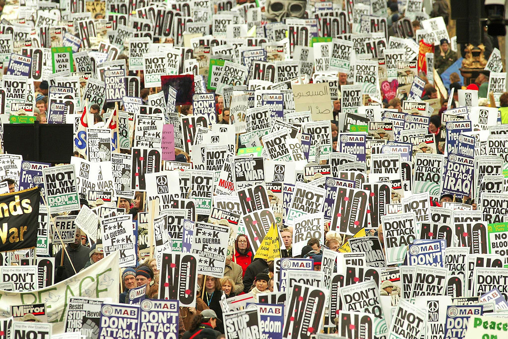 Description of . Anti-war protesters gather in London at the start of a demonstration against war on Iraq, February 15, 2003. Millions of people were expected to take to the streets of towns and cities across the globe to demonstrate against the looming U.S.-led war on Iraq in the biggest protests since the Vietnam war. REUTERS/Peter Macdiarmid