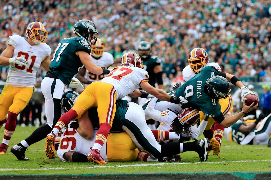 Description of . Quarterback Nick Foles #9 of the Philadelphia Eagles rushes for a first quarter touchdown against the Washington Redskins at Lincoln Financial Field on November 17, 2013 in Philadelphia, Pennsylvania.  (Photo by Rob Carr/Getty Images)