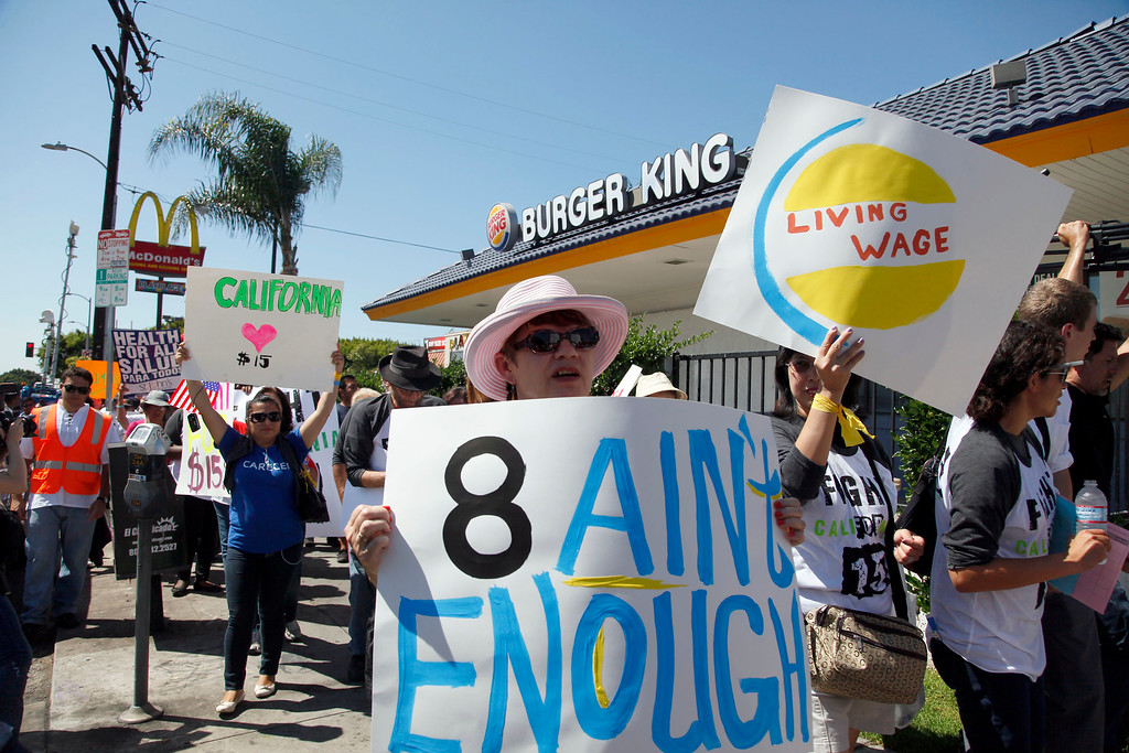 Description of . Protestors demonstrate outside a fast food restaurant on Thursday, Aug. 29, 2013, in Los Angeles.  (AP Photo/Nick Ut)