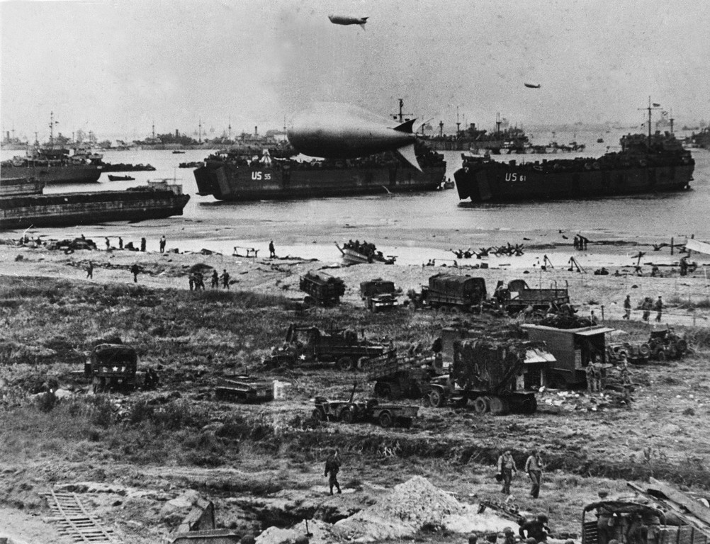 Description of . U.S. troops disembark from landing crafts during D-Day 06 June 1944 after Allied forces stormed the Normandy beaches. D-Day, 06 June 1944 is still one of the world's most gut-wrenching and consequential battles, as the Allied landing in Normandy led to the liberation of France which marked the turning point in the Western theater of World War II.     AFP PHOTO-/AFP/Getty Images