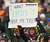 Fans of the Green Bay Packers hold a sign during a game against the Tennessee Titans at Lambeau Field on December 23, 2012 in Green Bay, Wisconsin. The Packers defeated the Titans 55-7. (Photo by Jonathan Daniel/Getty Images)