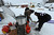 Musher Louie Ambrose gets hot water at the Iditarod checkpoint in McGrath on Wednesday, March 6, 2013, at Nikolai Airport in Nikolai, Alaska. (AP Photo/The Anchorage Daily News, Bill Roth)