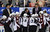 Colorado Avalanche coach Joe Sacco, center, talks to his team during the third period of an NHL hockey game against the Detroit Red Wings in Detroit, Tuesday, March 5, 2013. Detroit won 2-1. (AP Photo/Carlos Osorio)