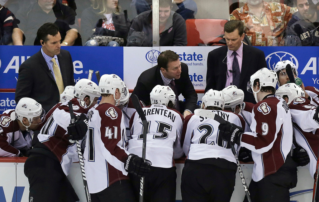 Description of . Colorado Avalanche coach Joe Sacco, center, talks to his team during the third period of an NHL hockey game against the Detroit Red Wings in Detroit, Tuesday, March 5, 2013. Detroit won 2-1. (AP Photo/Carlos Osorio)