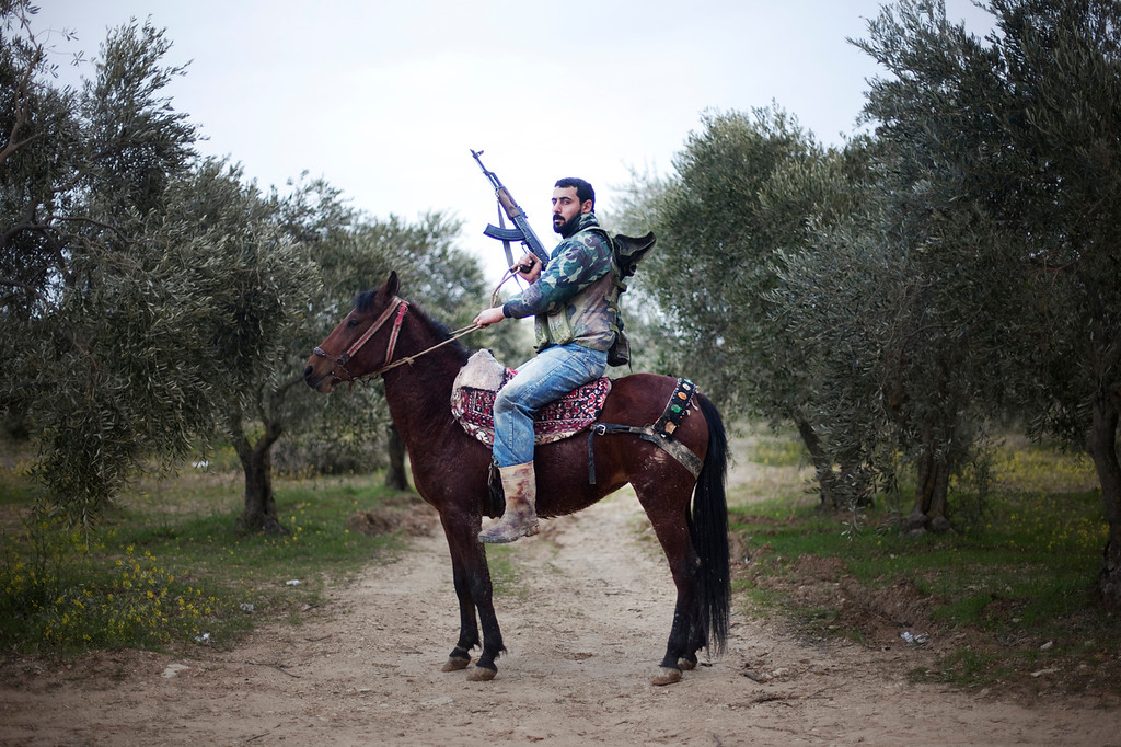 Description of . A portrait of a Free Syrian Army rebel mounted of his steed in Al-Shatouria village near to the Turkish border in northwestern Syria, on March 16, 2012, a year after a revolt against President Bashar al-Assad's regime erupted. (Giorgos Moutafis/AFP/Getty Images)