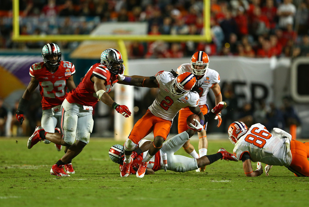 Description of . MIAMI GARDENS, FL - JANUARY 03: Sammy Watkins #2 of the Clemson Tigers runs with the ball against Joshua Perry #37 of the Ohio State Buckeyes in the fourth quarter during the Discover Orange Bowl at Sun Life Stadium on January 3, 2014 in Miami Gardens, Florida.  (Photo by Streeter Lecka/Getty Images)