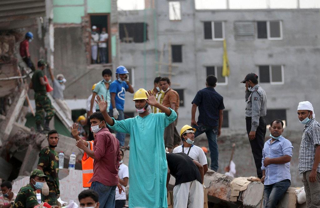 Description of . In this photo taken on Saturday April 27, 2013,  volunteer workers at the scene prepare for rescue work. When the Rana Plaza, a garment factory building collapsed, many of the first responders were neighborhood residents, fellow garment workers, relatives of the missing and charity workers, and they repeatedly took some of the most dangerous work.(AP Photo/Wong Maye-E)