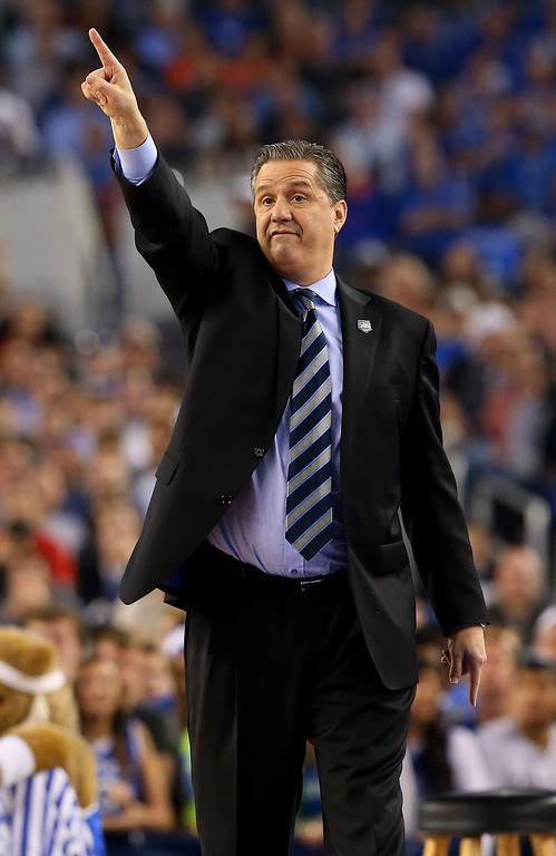 Description of . ARLINGTON, TX - APRIL 07: Head coach John Calipari of the Kentucky Wildcats motions to his players during the NCAA Men\'s Final Four Championship against the Connecticut Huskies at AT&T Stadium on April 7, 2014 in Arlington, Texas.  (Photo by Ronald Martinez/Getty Images)