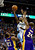 Denver Nuggets small forward Corey Brewer (13) drives on Los Angeles Lakers shooting guard Kobe Bryant (24) and point guard Chris Duhon (21) during the first half at the Pepsi Center on Wednesday, December 26, 2012. AAron Ontiveroz, The Denver Post