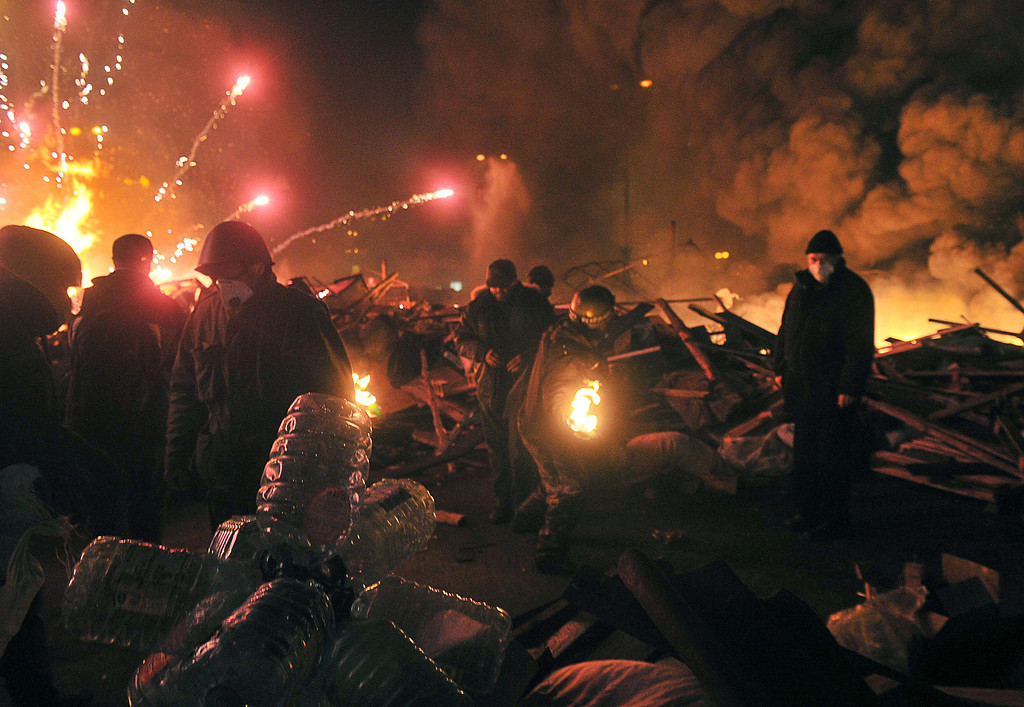 Description of . Anti-government protesters clash with the police during their storming of Independence Square in Kiev on February 18, 2014. AFP PHOTO/ GENYA SAVILOV/AFP/Getty Images