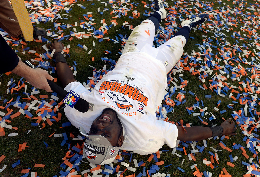 Description of . Denver Broncos running back Montee Ball (28) gets interviewed while on the field after winning the AFC Championship game.  The Denver Broncos vs. The New England Patriots in an AFC Championship game  at Sports Authority Field at Mile High in Denver on January 19, 2014. (Photo by Craig Walker/The Denver Post)