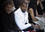 Kanye West, centre, attends the fashion designer Martin Margiela's Spring/Summer 2013 Haute Couture fashion collection, in Paris, Wednesday, Jan. 23, 2013. (AP Photo/Zacharie Scheurer)